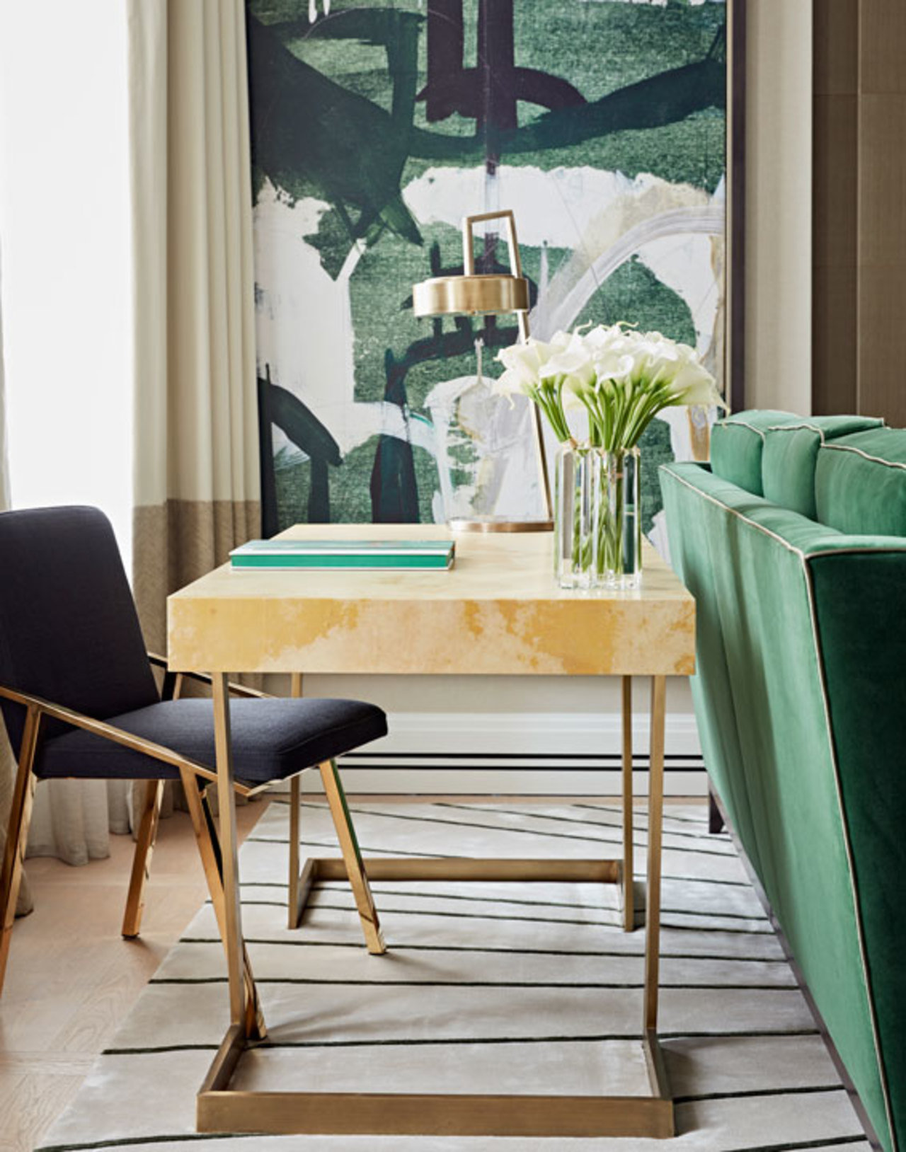 Designed by Taylor Howes London, this desk positioned behind the couch is a subtle way to incorporate
