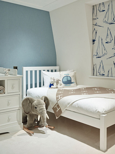 A whimsical sailboat patterned shade adds character in a sophisticated way to a child's room designed