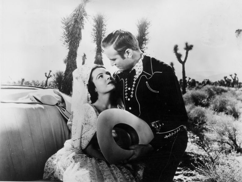 A sultry Lupita Tovar with co-star Gene Autry—one of the many stars Kohner and Tovar feted at their B