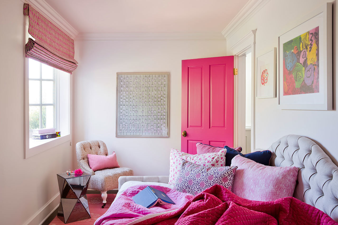 Bright pops of color and more sophisticated artwork and accent furniture make this room designed by C