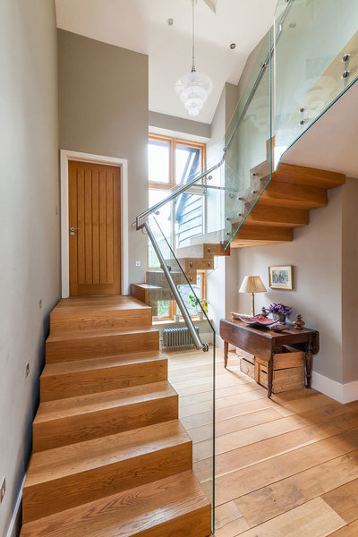 The oak floating staircase in a Henley-on-Thames farmhouse owned by Sue Laing