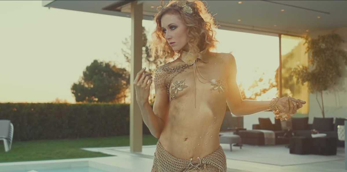 A promotional video uses sex appeal to sell the $100 million Opus spec home in Beverly Hills.