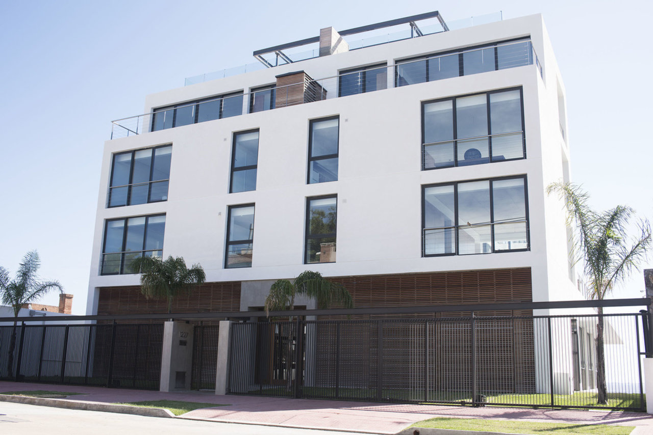 A two-bedroom apartment in this low-rise luxury condo at the foot of the ocean is listed for sale at